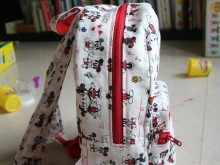 Minnie and Mickey backpack side view